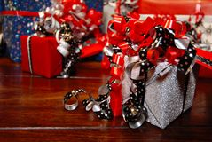 Christmas Gifts wrapped in wonderful coloured paper royalty free stock images