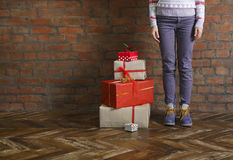Christmas gifts and young woman Stock Images