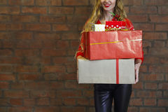 Christmas gifts and young woman Stock Image