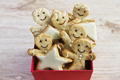 Christmas ginger biscuits in the red box. On the wooden background Stock Images