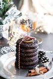 Christmas card ginger breads, and cookies on silver plate, black table, cinnamon stock image