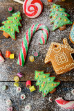 Christmas ginger cookies, cane, lollipop and candy strewn with snow Stock Image