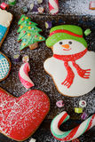 Christmas ginger cookies and sweet candy strewn with snow Stock Photography