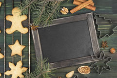 Christmas ginger gingerbreads with honey and cinnamon on a woode Royalty Free Stock Photos