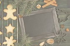 Christmas ginger gingerbreads with honey and cinnamon on a woode Royalty Free Stock Photo