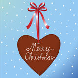 Christmas ginger heart. Cookie with red satin bow Stock Images