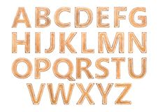 Christmas gingerbread alphabet font. Real gingerbread cookies set with glaze. Isolated textured letters on white background. stock photo