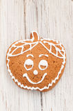 Christmas gingerbread apple on wooden background Royalty Free Stock Photography
