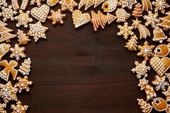Christmas gingerbread background. Christmas background. Homemade gingerbreads with copy space on wooden table royalty free stock photo