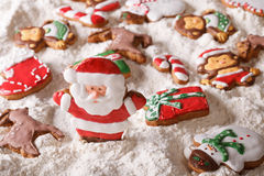 Christmas gingerbread on the background of white flour close-up. Royalty Free Stock Photos