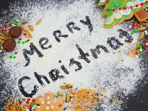 Christmas gingerbread on a baking sheet, sprinkled with flour stock image