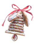 Christmas gingerbread bell. Christmas bell assembled from gingerbread shaped cookies and tied with red ribbon shot over white blue background Royalty Free Stock Images