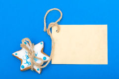 Christmas gingerbread cake star with icing and decoration and blank card Stock Photo