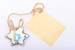 Christmas gingerbread cake star with icing and decoration and blank card Royalty Free Stock Photos