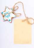 Christmas gingerbread cake star with icing and decoration and blank card Stock Photos