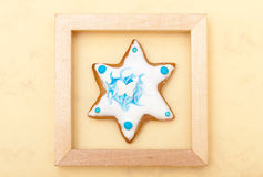 Christmas gingerbread cake star with icing and decoration in frame Stock Photo