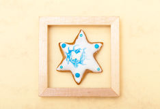Christmas gingerbread cake star with icing and decoration in frame Royalty Free Stock Images