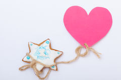 Christmas gingerbread cake star with icing and decoration and heart Stock Photo