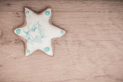 Christmas gingerbread cake star with icing and decoration on wooden board Stock Images
