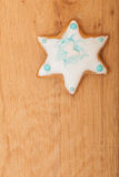 Christmas gingerbread cake star with icing and decoration on wooden board Royalty Free Stock Images