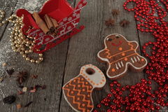 Christmas gingerbread cinnamon, Christmas decorations, tea, beads, Santas sleigh. Stock Images