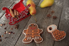 Christmas gingerbread cinnamon, Christmas decorations, tea, beads, Santas sleigh. Stock Photography