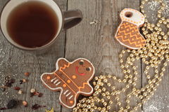 Christmas gingerbread cinnamon, Christmas decorations, tea, beads, Santas sleigh. Stock Photo
