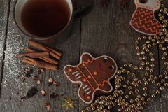 Christmas gingerbread cinnamon, Christmas decorations, tea, beads, Santas sleigh. Stock Photos