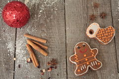 Christmas gingerbread cinnamon, Christmas decorations, tea, beads, Santas sleigh. Royalty Free Stock Image