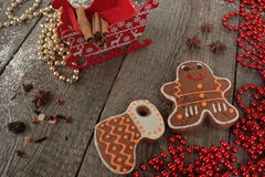 Christmas gingerbread cinnamon, Christmas decorations, tea, beads, Santas sleigh. Royalty Free Stock Photography