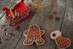 Christmas gingerbread cinnamon, Christmas decorations, tea, beads, Santas sleigh. Royalty Free Stock Photo