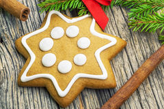 Christmas gingerbread with cinnamon sticks on a wooden table Royalty Free Stock Photography