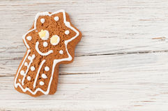 Christmas gingerbread comet on wooden background Royalty Free Stock Photos