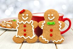 Christmas gingerbread cookie couple with hot chocolate Royalty Free Stock Images