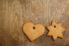 Christmas gingerbread cookie over wooden table Royalty Free Stock Photography