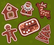Christmas gingerbread cookies. Set of vector elements on a festive background Stock Photos