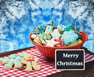 Christmas gingerbread cookies and a blackboard with congratulati Stock Images