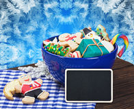 Christmas gingerbread cookies and a blackboard. For congratulations Royalty Free Stock Photo