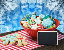 Christmas gingerbread cookies and a blackboard with congratulations Royalty Free Stock Photo