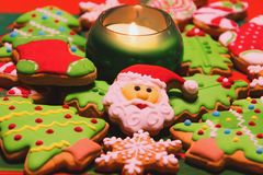 Christmas gingerbread cookies and candles on the table. Dominated by green and red colors Stock Photography