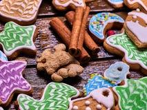 Christmas gingerbread cookies cinnamon sticks on woden table. Stock Image