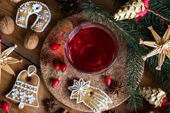 Christmas gingerbread cookies and a cup of rose hip tea, top vie Stock Image