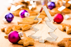Christmas gingerbread cookies with cutters and christmas baubles.  Stock Images