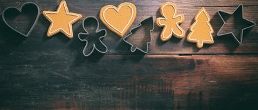 Christmas gingerbread cookies and cutters, top view, wooden background, banner stock photo