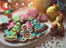Christmas gingerbread cookies decorated with colored frosting for new year, Christmas party, winter holiday, sweet home stock photo