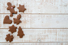 Christmas gingerbread cookies with different shapes over a white vintage wooden table Stock Photo