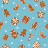 Beautiful Christmas ginger cookies, gingerbread cookies on blue background. Seamless texture, background. Christmas, gingerbread, cookies.  elements, symbols of Royalty Free Stock Images