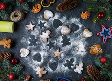 Christmas gingerbread cookies and fir tree and cones on dark stone background. Top Stock Images