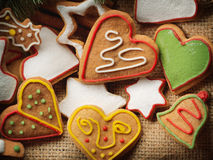 Christmas gingerbread cookies and fir tree on fabric background Stock Images