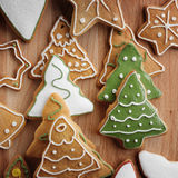 Christmas gingerbread cookies and fir tree on fabric background Royalty Free Stock Image